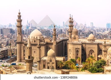 The Mosque-Madrassa of Sultan Hassan and the Pyramids in the background, Cairo, Egypt