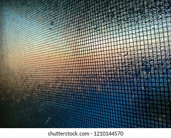 mosquito net wire screen on the window with water drops
