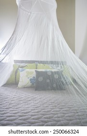Mosquito netting over a bed in tourist resort in Africa