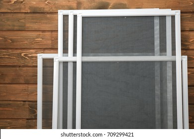 Mosquito window screens on wooden background