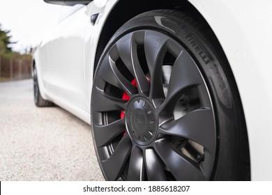 Moss Beach USA - January 1, 2021: 20 inch Uberturbine Wheels and Pirelli tires on electric car Tesla Model 3 dual motor performance AWD in pearl white