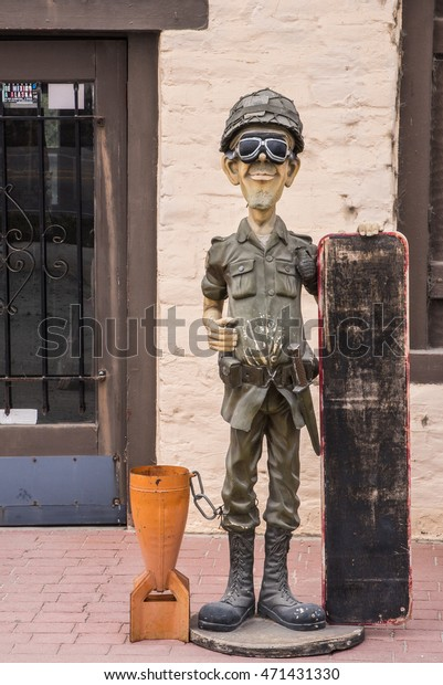 Moss Landing, California - August 11, 2016: A figure of an army soldier with goggles, a helmet and army boots stands on display in front of J and S's Eagle Iron and Leather Shop, along Highway 1.