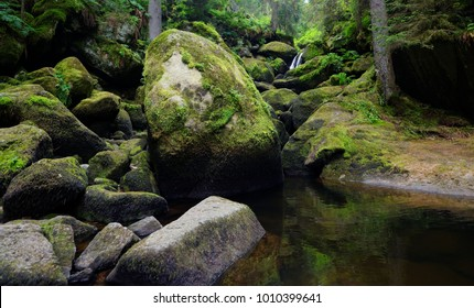 Moss and lichen covered boulders in Triberg waterfall in Germany