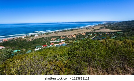 Mossel Bay holiday town along ocean coastline overlooking scenic landscape.