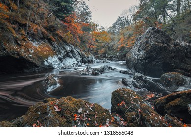 Mossy rocks of Fairy Glen Gorge waterfall at autumn in Snowdonia National Park, North Wales, UK