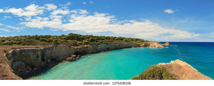 The most beautiful coast of Apulia: Torre Sant' Andrea, Otranto , ITALY (Lecce).Typical coastline of Salento: view of Punticeddha beach. Seascape with cliffs, rocky arch and sea stacks.