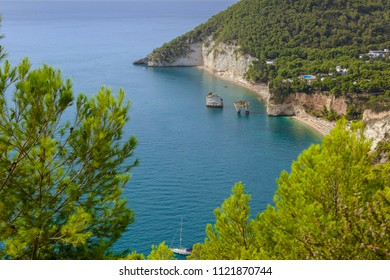 The most beautiful coasts of Italy:Zagare Bay (Apulia).The beaches offer a breathtaking view with brigthly white karstic cliffs,emerald-blue sea,lush greenery of olive-trees,pine-woods.