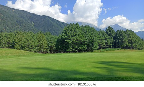 most beautiful green grss,forest mountains and blue sky with clouds