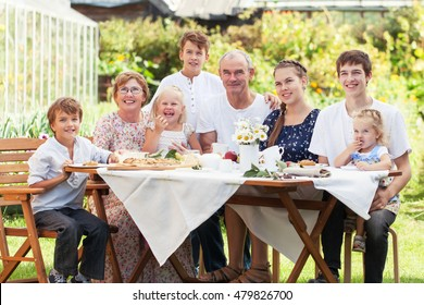 Most Beautiful Happy Family In Summer Garden, Portrait Of Two Generations,  Grandparents With Grandchildren