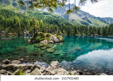 Most beautiful lake in Switzerland Saoseo Lake Val da Camp in Poschiavo Valley Switzerland which is a stunningly beautiful mountain lake in the Swiss Alps that offers superb hiking in serene nature
