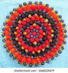 Most beautiful mandala fruits on the plate.