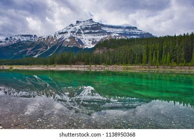 The most beautiful reflection of a mountain on a perfectly clear lake. This scenery gives a relaxing zen feeling.