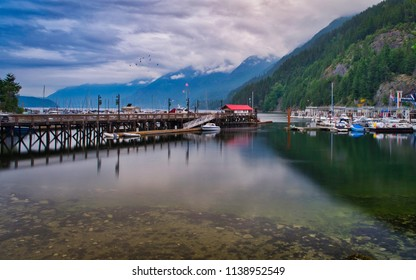 Most beautiful scenery of a small town harbor. Horseshoe bay will take you too Vancouver Island. The wonderful bay reflect the mountains on the clear water. Boats and ships are waiting to ship.