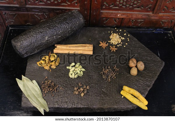 Most common and flavourful Indian Spices. Spices used in Indian food. Spices in traditional masala grinding stone
