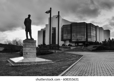 Most, Czech republic - March 18, 2017: Silhouette of statue Tomas Garrigue Masaryk in front of theater building