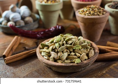Most expensive spice in the world dried green cardamom pods with black seeds, used as an ingredient in many cuisines and for medical use close up