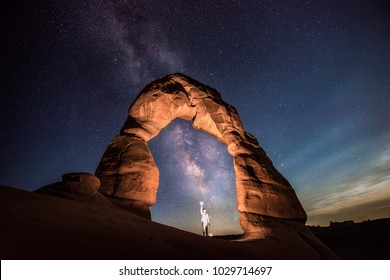 The most famous arch in Arches National Park. I used low light level lighting skill to light up the arch, and created a magical scene with the milky way behind.