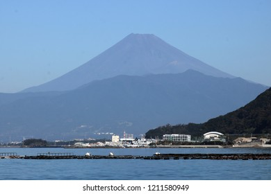 The most famous beautiful volcano mountain in Japan, Fuji Mount. or Fujisan, in a clearly summer day, viewing from the Numazu Bay at Shizuoka Province.