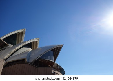the most famous landmark sydney opera house designed by denmark Architect Jørn Utzon. in a blue sunny day shining the white roof tile on the top.