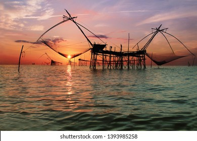 The most famous landmark of wonderful Place in Phatthalung Southern of Thailand.The traditional of big fish square dip nets stand in the lake at Pak pra village.The morning light upon the scene.