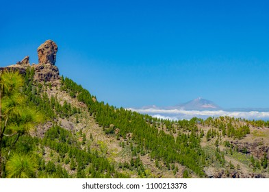 The most famous landmarks of canary islands with Rogue Nublo in Gran Canaria in the foreground and with Teide in Tenerife in the background