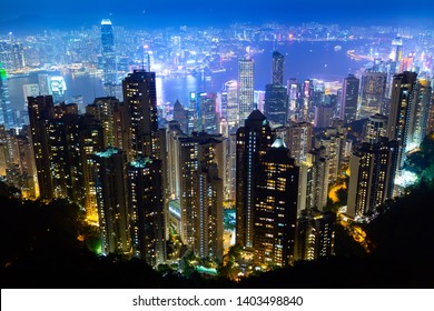 The most famous view of Hong Kong at twilight sunset. Hong Kong skyscrapers skyline cityscape view from Victoria Peak illuminated in the evening. Hong Kong, special administrative region in China.