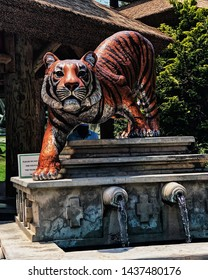 The most ferocious of creatures, the Bengal Tiger, maintains a calm yet fearful watchful eye on those who dare to meander past his statue
