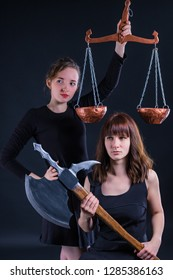 The most honest fair court, weighing the pros and cons. Crazy halloween concept. Girls with Libra and ax.