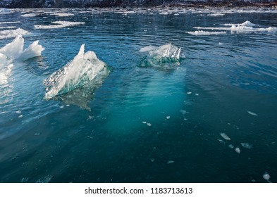 Most of the Iceberg is Underwater near the Eqip Glacier in Western Greenland