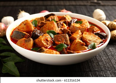 Most popular and simple homemade  red spicy King fish curry served with spices.