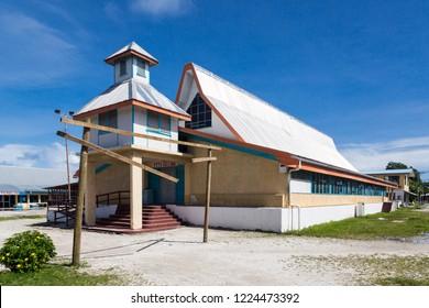 Most prominent building on Funafuti atoll is Fetu Ao Lima (Morning Star Church) of the Church of Tuvalu. Tausoa Lima Falekaupule (the traditional meeting house)  seen in the back. Polynesia, Oceania.