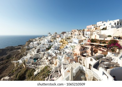 Most Romantic Greek Oia town on Santorini island, Greece. Traditional and famous houses and churches with blue domes over the Caldera, Aegean sea. Santorini classically Thera and officially Thira.