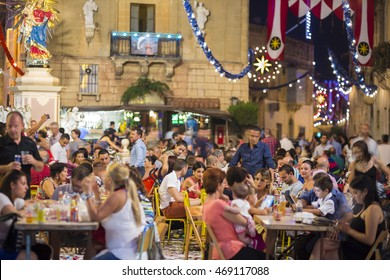 MOSTA, MALTA - 15 AUG. 2016: The Mosta festival at night with celebrating maltese people. People of Malta are celebrating the Feast of the Assumption, also known as the feast of 'Santa Maria'.