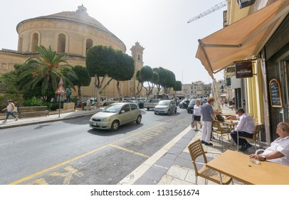 Mosta, Malta - July 6, 2018: City Life in Mosta, view from Constitution Street towards Rotunda