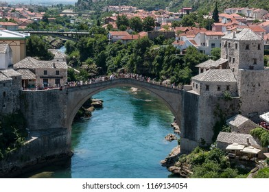 Mostar, Bosnia - 5/07/2018: the Stari Most (Old Bridge), 16th century Ottoman bridge, symbol of the city, destroyed on November 9, 1993 by the Croatian military forces during the Croat-Bosniak War