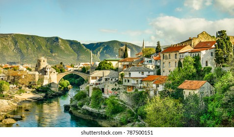 MOSTAR, BOSNIA - APRIL 08, 2017: Panorama of the Stair Most (Old Bridge), Neretva River, the Tara and Halebija towers.