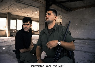 MOSTAR, BOSNIA - AUGUST 3: Bosnian Croat soldiers occupy a building during heavy fighting in the Bosnian city of Mostar Aug 3, 1994 in Sarajevo, Bosnia.