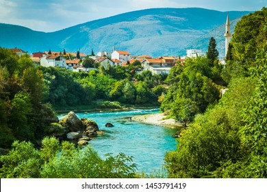 Mostar, Bosnia & Herzegovina - Aug 17, 2017:   Old town Mostar bridge, restaurants, mosque, culture, river