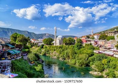Mostar, Bosnia and Herzegovina – August 30. 2019: Mostar Old Town with the Karadjozbegova mosque and the Neretva river.