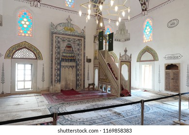 MOSTAR, BOSNIA AND HERZEGOVINA - JULY 11, 2018: interior of Koski Mehmed Pasha Mosque with mihrab and qubba