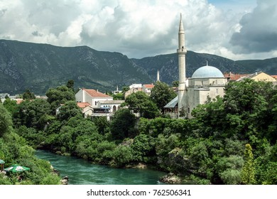 MOSTAR, BOSNIA AND HERZEGOVINA - JULY 6, 2008:Karadjozbegova mosque seen from its opposite bank of the river Neretva in Mostar, Bosnia and Herzegovina. It is one of the landmarks of the city.