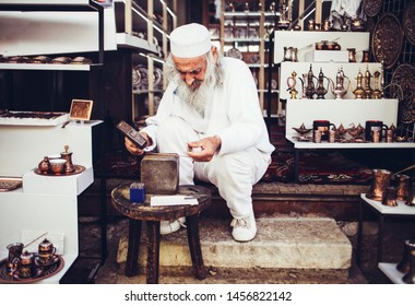 Mostar, Bosnia and Herzegovina; May 2, 2019: Old craftmen jeweller working in his shop in Mostar historic old city area.