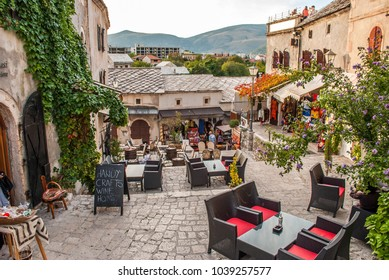 Mostar, Bosnia and Herzegovina - October 01, 2010: The promenade, with many cafes and shops, Mostar