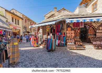 MOSTAR, BOSNIA AND HERZEGOVINA - SEPTEMBER 23: Mostar old town street with shops and historic architecture on September 23, 2016 in Mostar