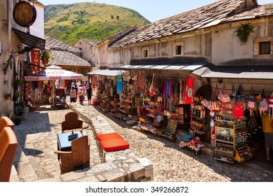MOSTAR, BOSNIA AND HERZEGOVINA-JULY 20: People walking through the Old Town with many shops and cafes on July 20, 2014 in Mostar, Bosnia and Herzegovina. Mostar is situated on the Neretva River.