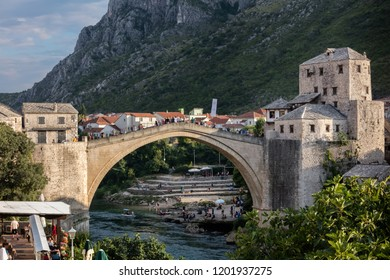 Mostar, Bosnia, July 28, 2018: Mostar's Old Bridge, an exemplary piece of Islamic architecture, built by the Ottomans in the 16th century,  one of Bosnia and Herzegovina's most recognizable landmarks