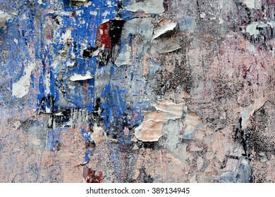 a mostly pink and blue background image of spraypaint and torn posters