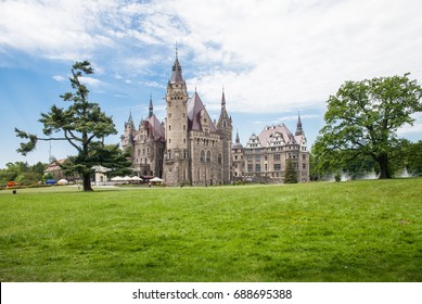 MOSZNA, POLAND - APRIL 23, 2017 ; The Moszna Castle is a historic palace located in a small village in Moszna is one of the best known monuments in Upper Silesia.