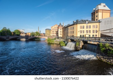 Motala river and the old industrial landscape of Norrkoping during early spring. Norrkoping is a historic industrial town in Sweden.