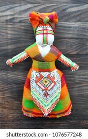 Motanka doll on the wooden background